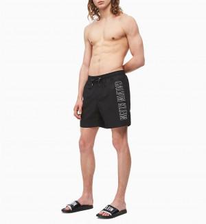 Pánské plavecké šortky KM0KM00381-BEH černá - Calvin Klein černá