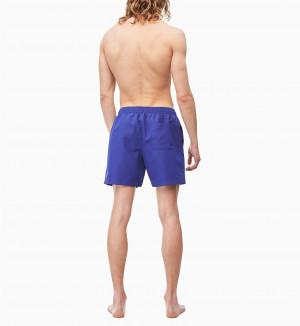 Pánské plavecké šortky KM0KM00403-CDT fialová - Calvin Klein fialová